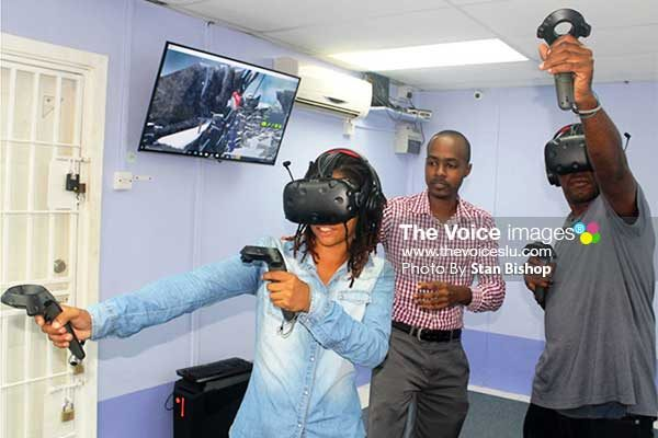 Image: Jano James (centre) supervising two gamers enjoying the VR experience. [PHOTOS: Stan Bishop]