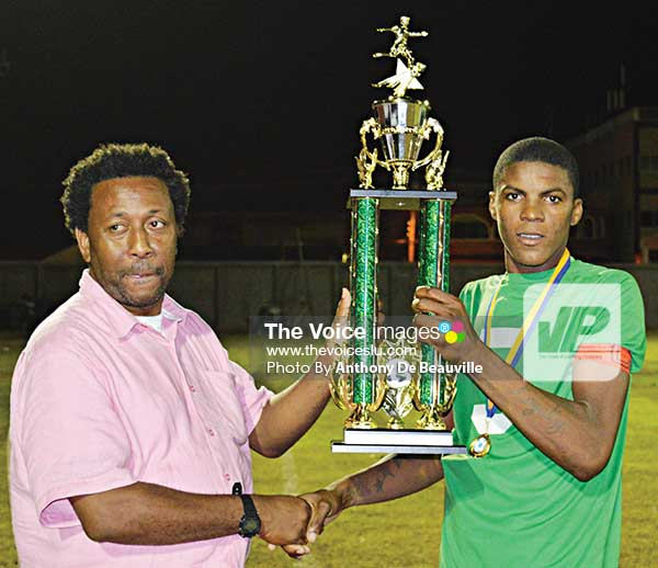 Image: SLFA president Lyndon Cooper presenting award to Jervic Mc Farlane (VFS) Best Striker and MVP of the tournament. (Photo: Anthony De Beauville)