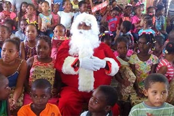 Image: Students at the Gros Islet Infant School with Santa.