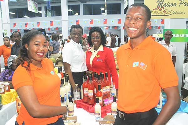 Image: Two Sir Arthur Lewis Community College Business students were volunteers for Abby's at the exhibition