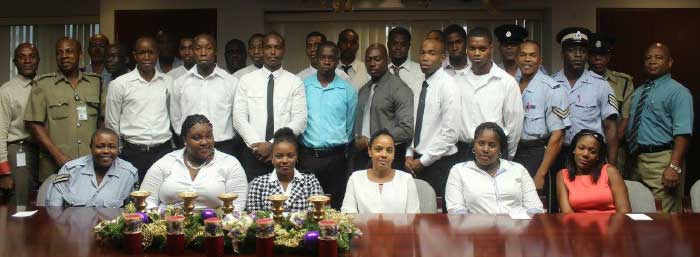 Image: The recruits with police and SLASPA officials