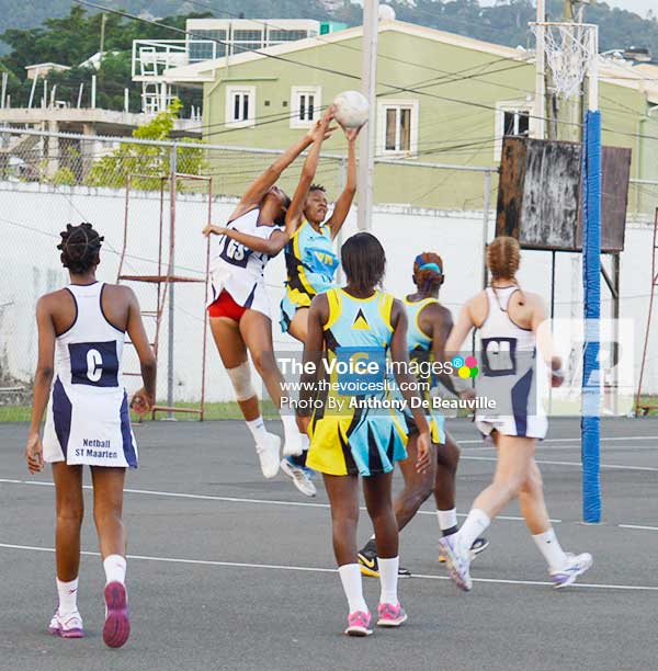Image: Saint Lucia's wing attack Romela Hunte collect a high overhead pass to deny Saint Maarten  goal shooter a scoring opportunity. (Photo: Anthony De Beauville)