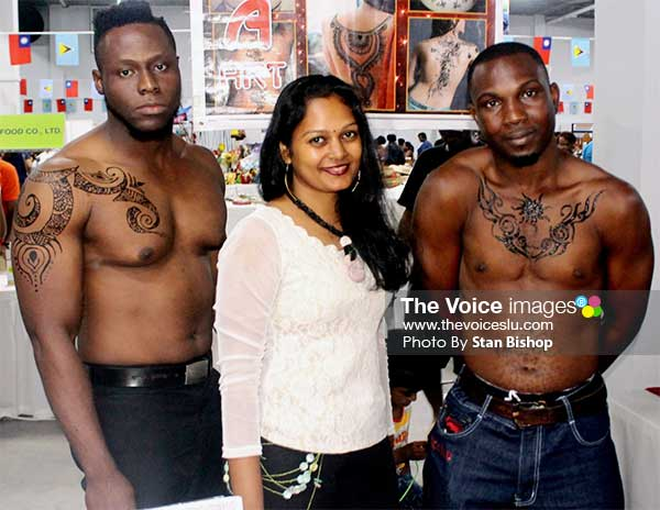 Image: Heera Patra (centre) with two models showcasing her henna art at a recent exhibition. [PHOTO: Stan Bishop]