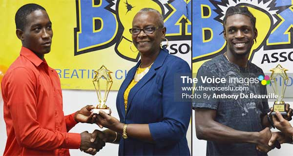 Image: (L-R) Nathan Ferrari and Lyndell Marcellin receiving awards from SLOC President Fortuna Belrose. (PHOTO: Anthony De