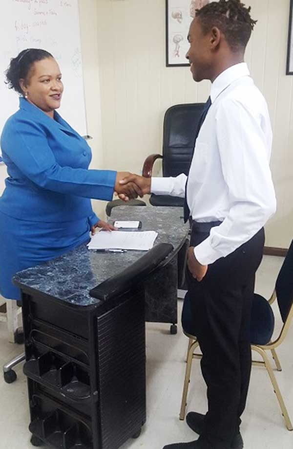 Image: Sydwina Alexander performs mock interviews with students