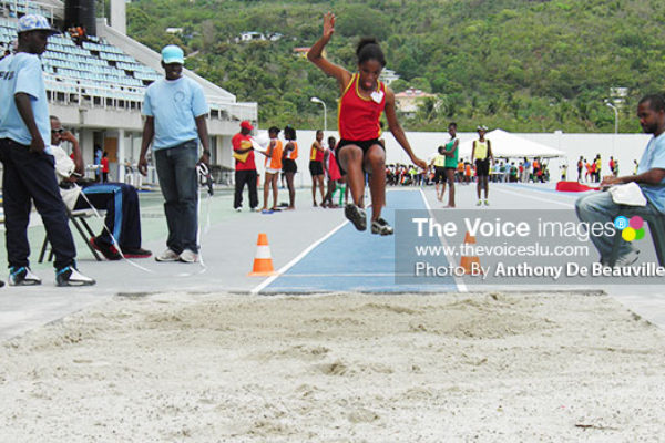 Image: Field event officials keeping a close eye in the ladies' long jump. (Photo: Anthony De Beauville)