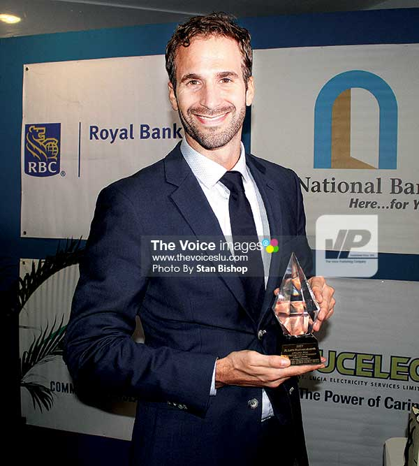 Image: Windward and Leeward Brewery Limited's Erik Hammer with the company's Award for Excellence in Human Resource Development.