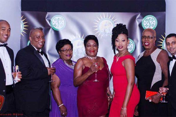 Image of Bay Gardens executives celebrate