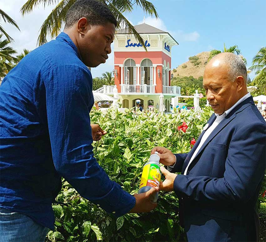 Image: Dujon (left) tells Sandals Grande GM Winston Anderson about his product.