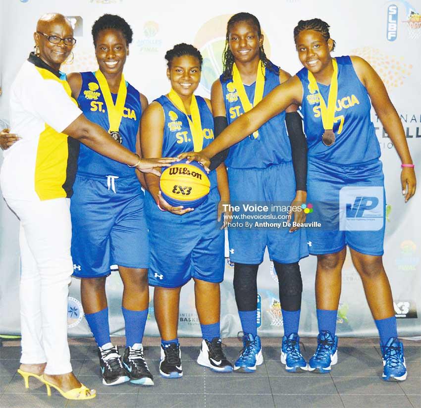 Image: Silver medallist presenter SLOC President Fortuna Belrose celebrates with Team Saint Lucia. (PHOTO: Anthony De Beauville)