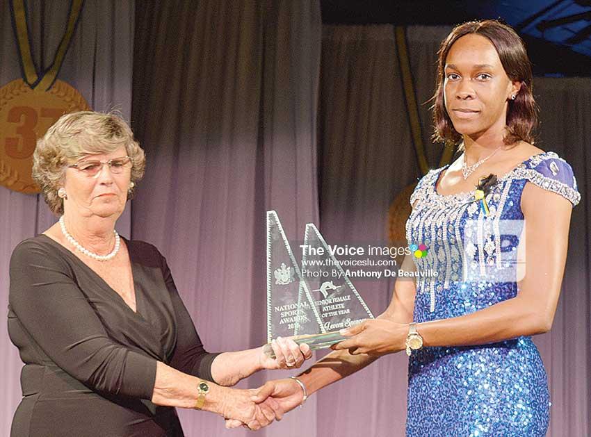 Image: Jane Duboulay presenting Levern Spencer with the senior female athlete of the year award. (Photo: Anthony De Beauville)