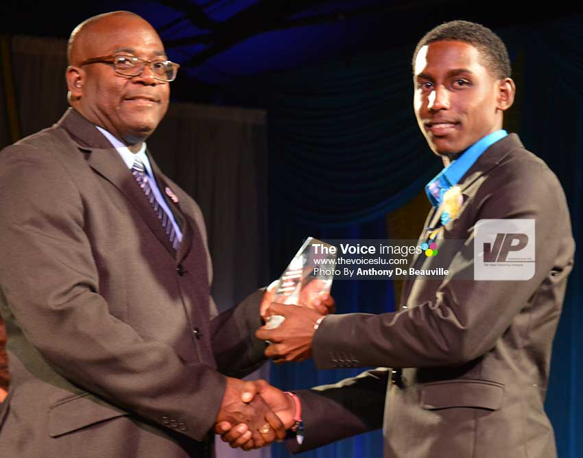 Image: Sports Minister Edmund Estaphane presenting Junior Sportsman of the Year award to Johnnel Eugene. (Photo: Anthony De Beauville)