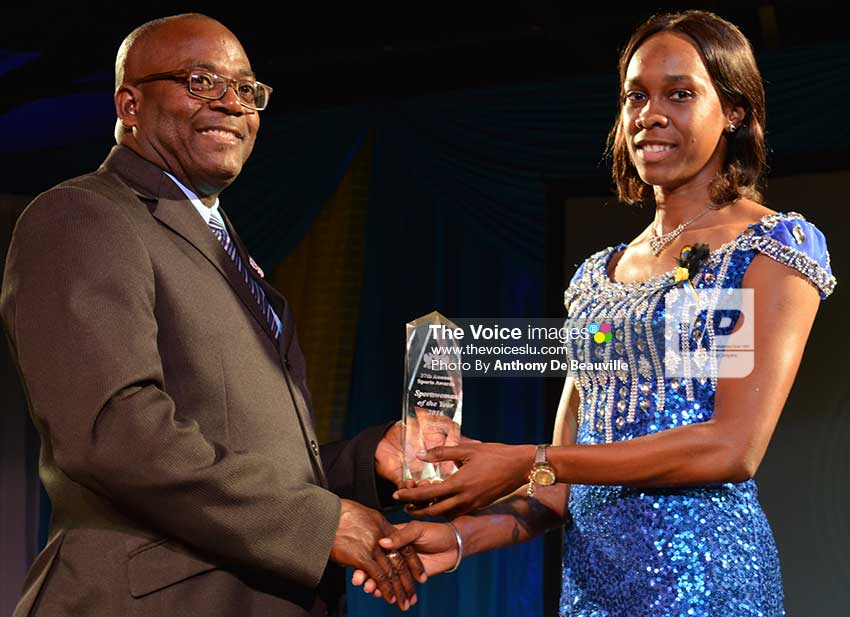 Image: Sports Minister  Edmund Estaphane presenting Levern Spencer with the Sportswoman of the Year  title. (Photo: Anthony De Beauville)