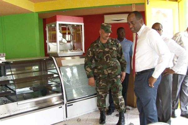 Image: Prime Minister Rooservelt Skerrit gets a first-hand look at the destruction.