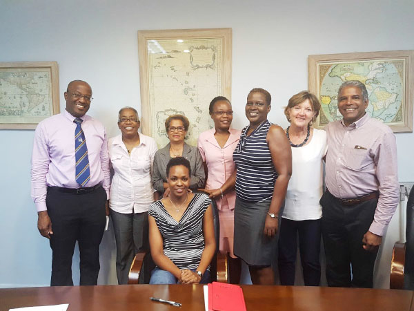 Image: Sitting – Dr Tamara Remy; Standing from left to right: Dr Christy Daniel, Dr Jackie Bird, Ms Pat Timothy, Ms Lista Louis, Ms Adeline Jean, Mrs Dagmar Peterkin, Dr David Bristol
