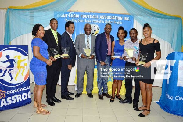 Image: Vieux Fort South celebrate their achievement with SLFA President Lyndon Cooper and Veterans in Sports Inc CEO Alvin Malaykhan (Photo: Anthony De Beauville)