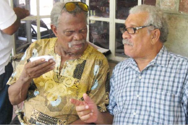 Image of Dunstan St. Omer and Derek Walcott at the launch of the Harold Simmons Folk Academy in October 2012.