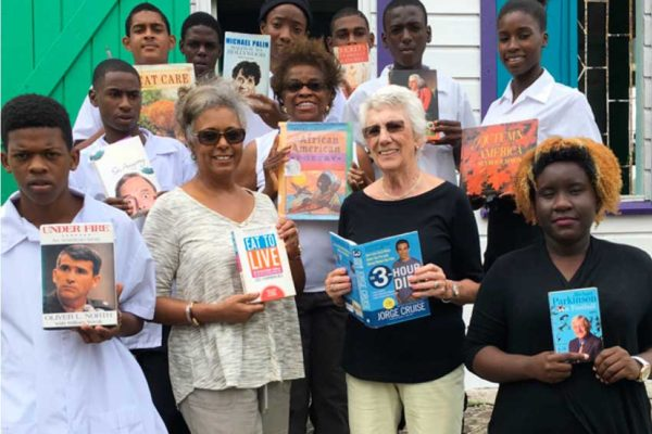 Image: Grow Well members display some of the books that will be on sale