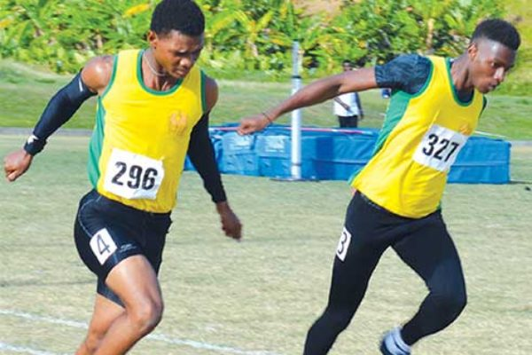 Image: (Left) Choiseul Secondary Jeanmeachel Etienne and Kenneth Verneuil in epic finish in the boys under 18 - 200 metres final; (right) Kimani Alphone of Vieux Fort Comprehensive wins the girls under 18 - 200 metres finals. (PHOTO: Anthony De Beauville)
