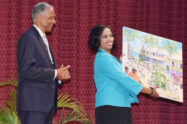 Image: Justice Saunders receives a gift from the Government of St. Kitts.