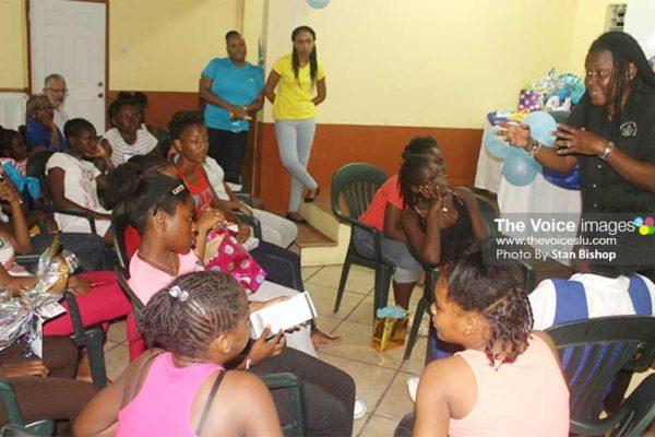 Image: Social Planning Officer, Tara Emmanuel, teaching the girls ways to develop and maintain high self-esteem. [PHOTO: Stan Bishop]