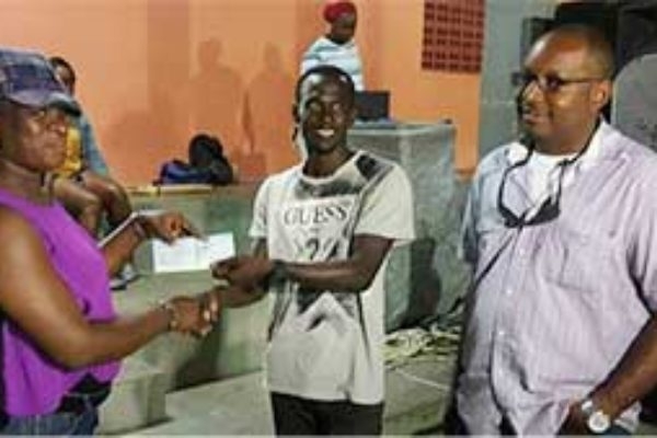 Image: VFS Football League 1st Vice President JeffaBelasse receiving sponsorship cheque for the Tournament from a representative of O.B. Sadoo Engineering, while Managing Director Bradly Sadoo(Photo: VFSFL)