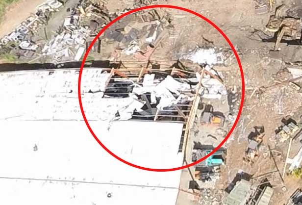 Image: Torn roof of workshop