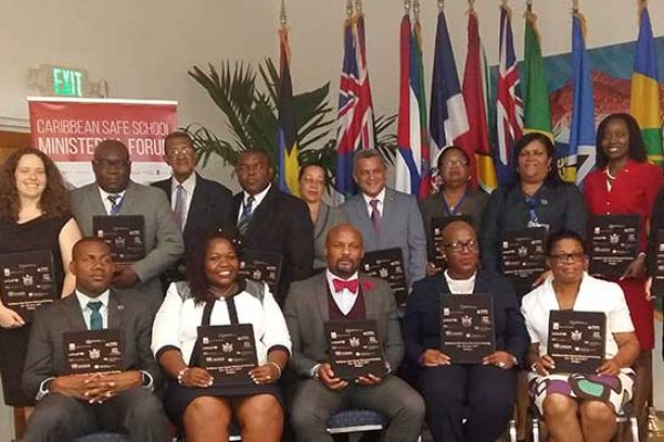 Image: Caribbean Ministers and other high-level officials from the Education sector pose with the signed Antigua and Barbuda Declaration on for School Safety during the Caribbean Safe School Ministerial Forum.