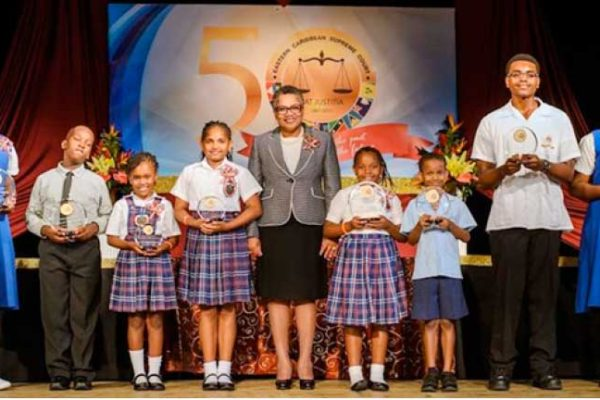 Image: Chief Justice Dame Janice Pereira with the competition winners.