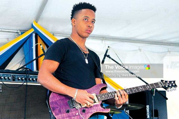 Image: Dynamix band leader Dwight Florent riffing away at a recent gig in Constitution Park. [PHOTO: Stan Bishop]