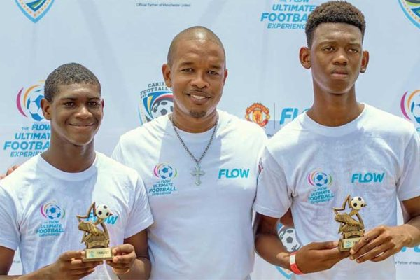 Image: Jeremiah Justin (left) and Djal Augustin (right) with FLOW Saint Lucia Acting Marketing Manager, Terry Finisterre.