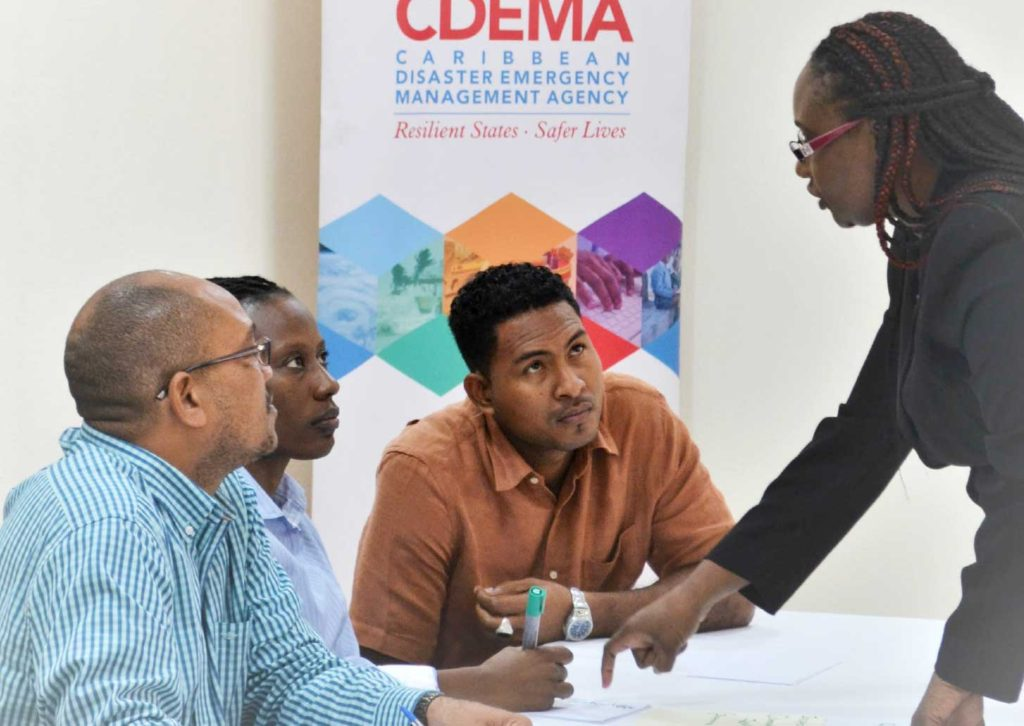 Image: Members of the ODM Dominica Staff during an orientation session at the CDEMA Coordinating Unit. L-R: Fitzroy Pascal, National Disaster Coordinator (Ag.), Karen ReviereCuffy, Programme Officer and Donalson Frederick, Programme Officer with Andria Grosvenor, Planning and Business Development Manager, CDEMA.