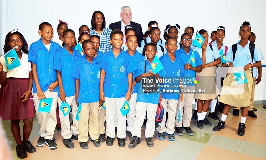 Image: Prime Minister Chastanet (in back row) with three-time Olympian Levern Spencer and students at the official opening ceremony.(Photo: Anthony De Beauville)
