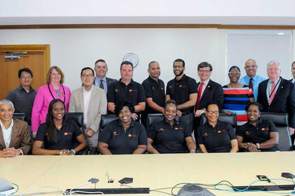 Image: Senior Executives of CIBC FirstCaribbean join the bank's 2016 Achievers in the boardroom of its corporate headquarters in Barbados.