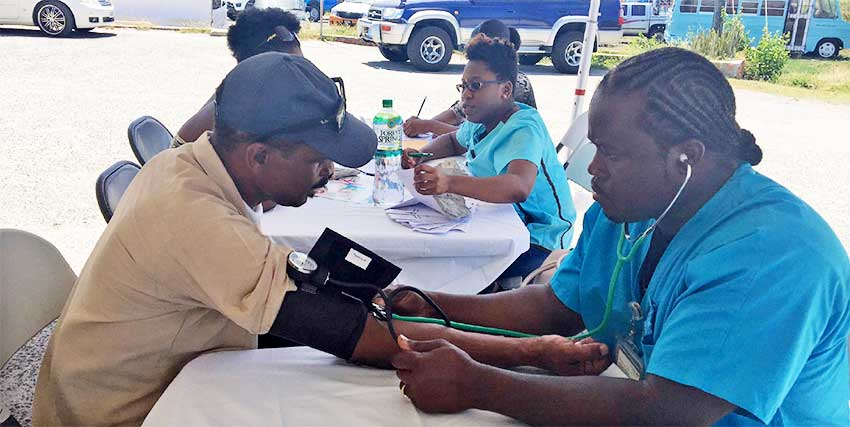 Image: Volunteers being tested for high blood pressure.