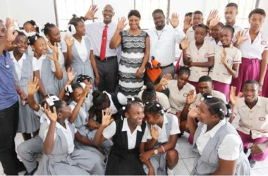 Image: A group of secondary school students say thanks as they are joined by ECTEL Managing Director Embert Charles, Mayor of Arcahaie, Ms. Rosemila Sainvil Petit-Frere, and Director General of the Public Library and ICT Center Charles Rogles.