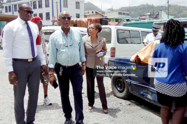 Image: CCC officials tour Castries yesterday.