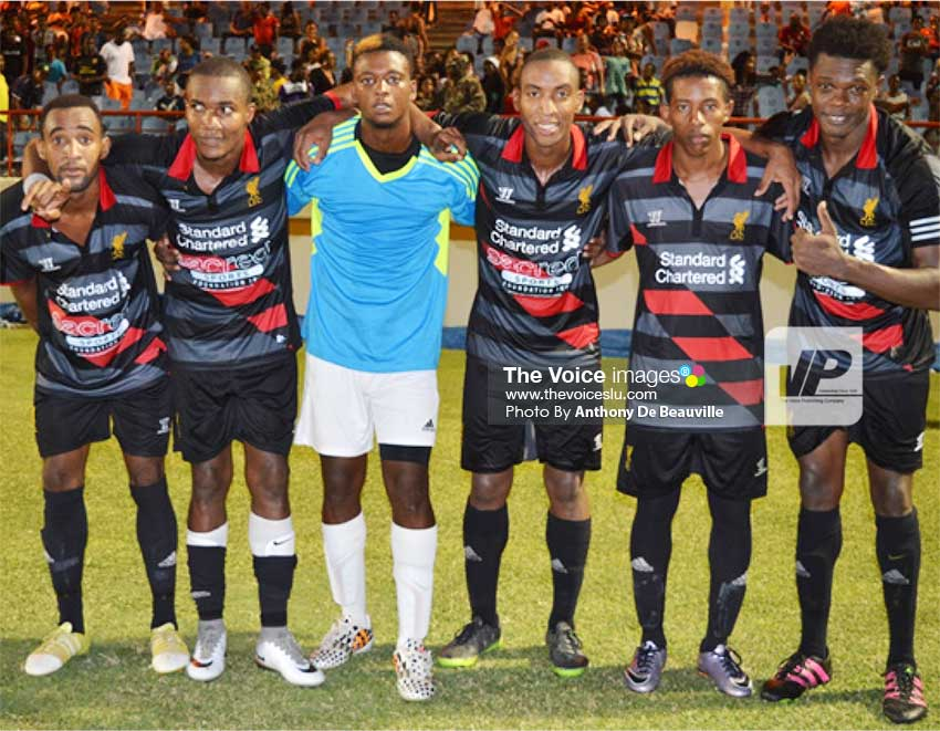 Image: Canaries' five goal scorers (penalty kicks) and goalkeeper Quami James take a photo moment as they celebrate their stunning victory over Micoud. (Photo: Anthony De Beauville)
