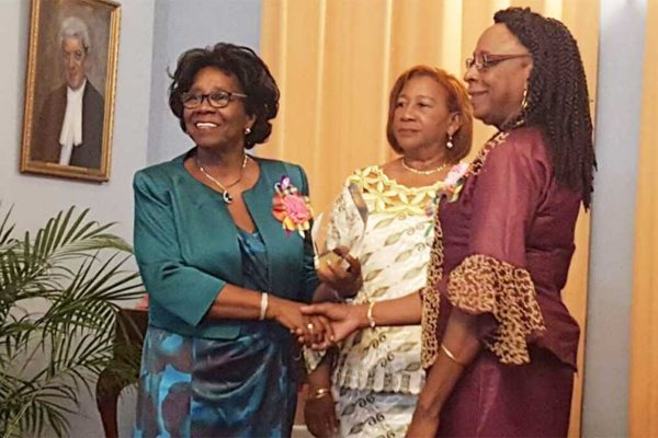 Image: From left to right: Governor General Dame PearletteLouisy; Manager of Les Danseurs, Olimtheia Constantin and Joyce Auguste.