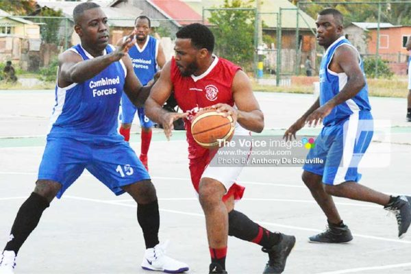 Image: Highlights from the game between Police and Dennery Dolphins on Saturday on the Vieux Fort Court. (Photo: Anthony De Beauville)