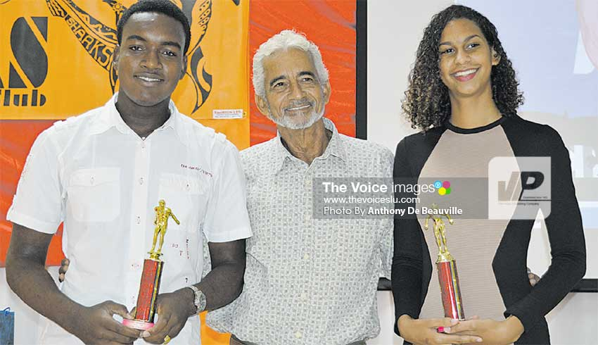 Image: (L-R) 13 – 14 male and female swimmers Nyeem Rosemond and Katie Kyle with award presenter David Peterkin.  (PHOTO: Anthony De Beauville)