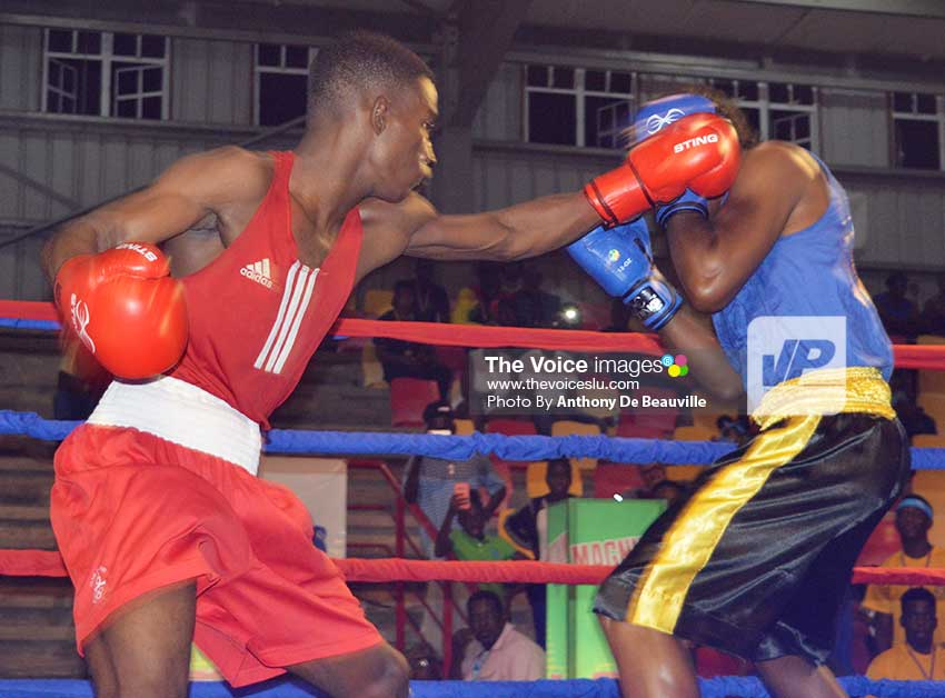 Image: Saint Lucia Nathan Ferrari (red) up against Jean Phillip–Erin of Grenada. (Photo: Anthony De Beauville)
