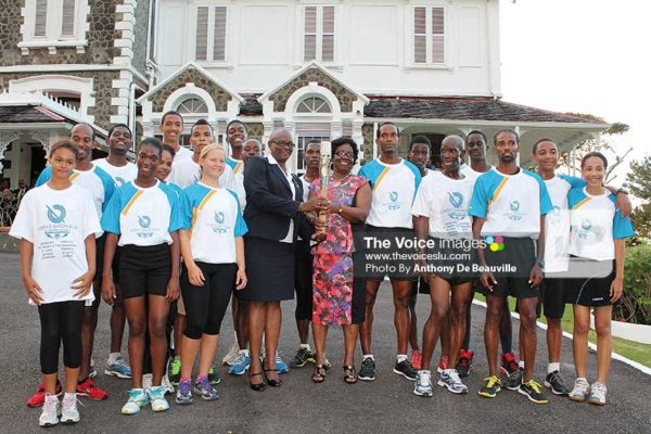 Image: A photo moment for these young aspiring athletes with Governor General Dame Pearlette Louisy and SLOC President Fortuna Belrose. (Photo: Anthony De Beauville)