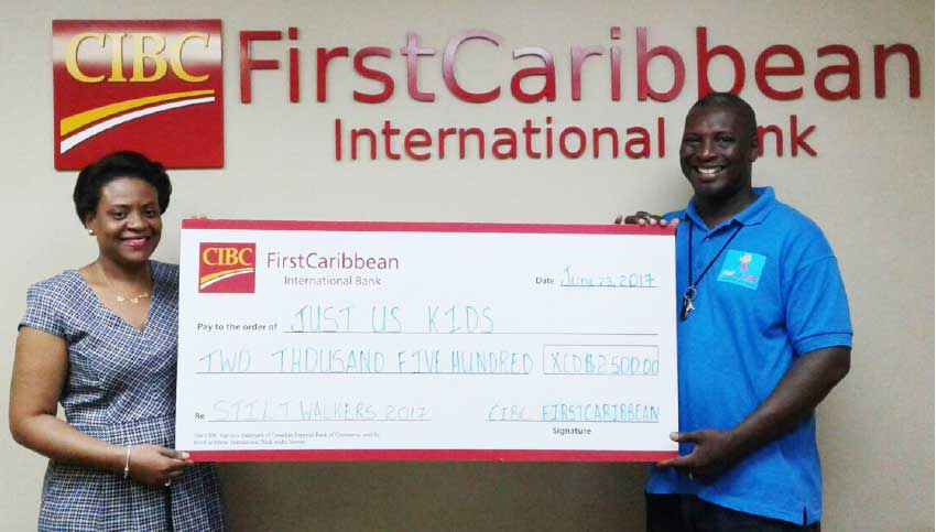 Image: Barry George of Just Us Kids receives the cheque from Carol Mangal, Manager Loans and Mortgages.
