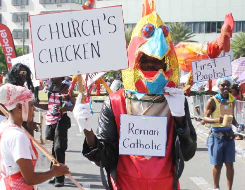 "Image: Cuthbert ""Twatinay"" Modeste displaying his ole mas costume during the 2013 carnival season. [PHOTO: Stan Bishop]"