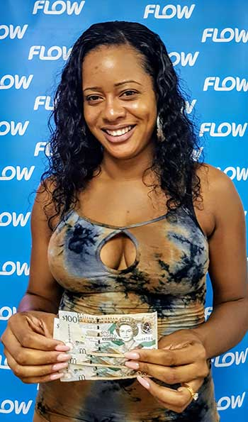 Image: Dwina Charlery of Mon Repos won $300.00 just by topping up her Flow mobile!