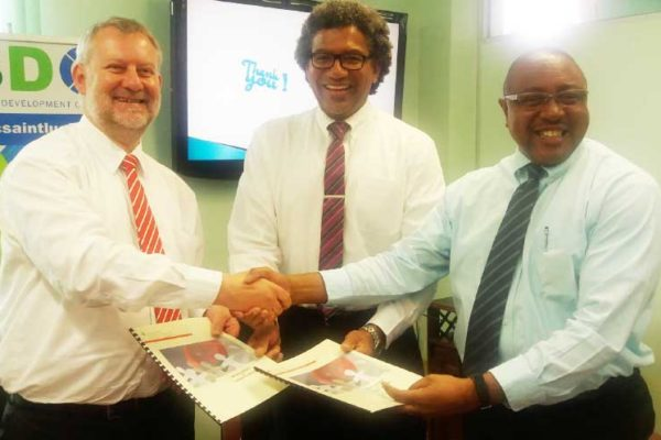 Image: (Left to right) Engel, Minister Felix and Titus Preville.
