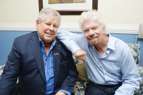 "Image: Gordon ""Butch"" Stewart (left), Chairman and Founder of Sandals Resorts International, and Richard Branson (right), Founder of Britain's Virgin Group."
