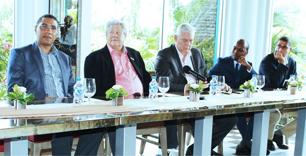 "Image: (from left to right) – Jamaican Prime Minister Andrew Holness, Sandals Chairman/Founder Gordon ""Butch"" Stewart, Prime Minister Allen Chastanet, Minister Dominic Fedee and Senior Project Manager, SRI, Mark Harding. [PHOTO: Stan Bishop]"