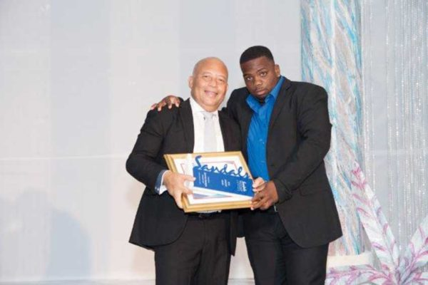 Image: Diamond Team Member, Jammer Georges, receives his award from General Manager, Winston Anderson.